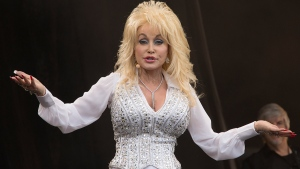 Dolly Parton performs on the main Pyramid stage at Glastonbury music festival, England, Sunday, June 29, 2014. (Photo by Joel Ryan/Invision)