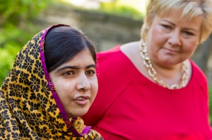 Pakistani school pupil and education activist Malala Yousafzai meets with Norwegian Prime Minister Erna Solberg, right, outside the prime minister's residence in Oslo Saturday June 14, 2014. (AP Photo: Vegard Grott / NTB scanpix/Pool)