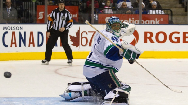 d235e19571f Vancouver Canucks goaltender Roberto Luongo makes a save against the  Toronto Maple Leafs in Toronto on