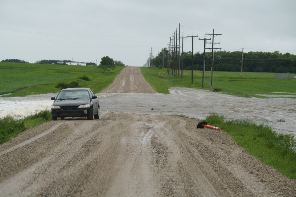 A road is blocked due to flooding in Manitoba, Sunday, June 29, 2014. (Irving Collins / MyNews)