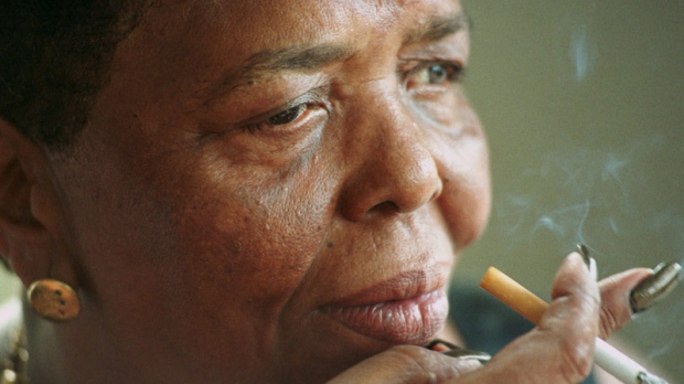 "In this Sept. 7, 2000 file photo singer Cesaria Evora known as the ""Barefoot Diva,"" smokes a cigarette during an interview at her home in Mindelo, on the Cape Verde island of Sao Vicente. (AP Photo/Armando Franca, file)"
