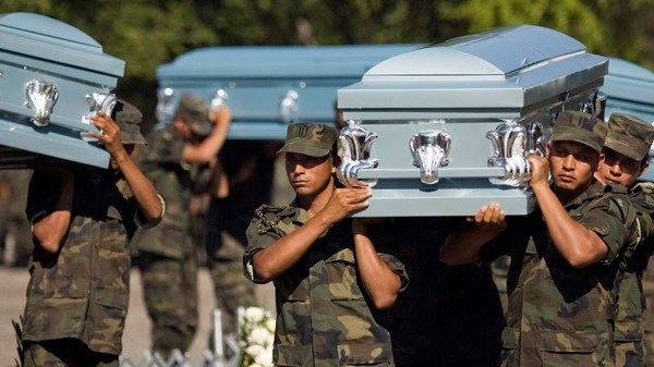 Soldiers carry coffins during the funeral of six members of Mexico's Army that were found decapitated in Chilpancingo, Mexico. (AP Photo/Claudio Cruz, File)
