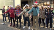 Several teens danced and sang in a flash mob held against climate change in downtown Vancouver. Dec. 18, 2011. (CTV)