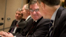 Federal Finance Minister Jim Flaherty, centre, speaks to Bank of Canada Governor Mark Carney prior to to a provincial, territorial and federal finance ministers meeting in Victoria, B.C., Monday, Dec. 19, 2011. (Geoff Howe / THE CANADIAN PRESS)