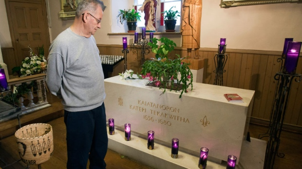 Deacon Ron Boyer looks at the tomb of Kateri Tekakwitha at St. Francis Xavier Church, Monday, December 19, 2011 in Kahnawake, Que, south of Montreal