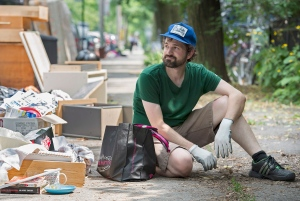 Professional scavenger Martin Gregory takes a break as he searches for discarded treasures in Montreal on Tuesday, July 1, 2014. (Graham Hughes / THE CANADIAN PRESS)