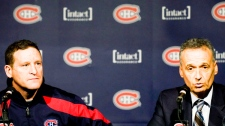Randy Cunneyworth listens to Montreal Canadiens' general manager Pierre Gauthier speak at a news conference in Montreal Saturday, December 17, 2011 naming him as interim head coach of the Montreal Canadiens. THE CANADIAN PRESS/Graham Hughes