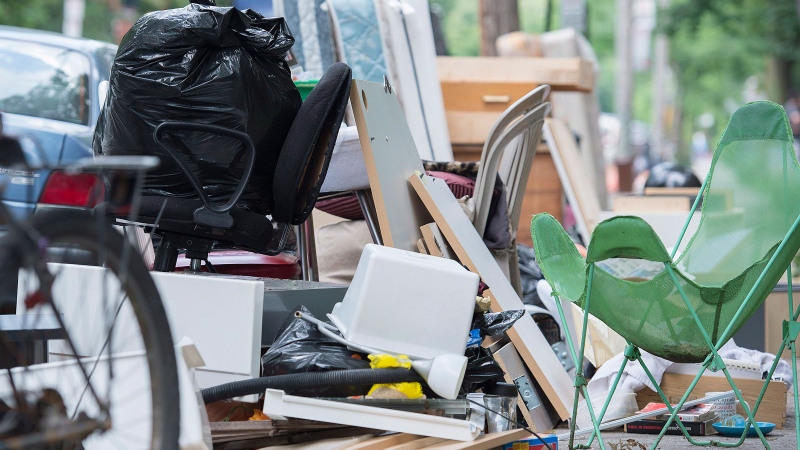 Discarded furniture is shown on a street in Montreal, Tuesday, July 1, 2014, on what's now known as moving day in Quebec. (Graham Hughes / THE CANADIAN PRESS)