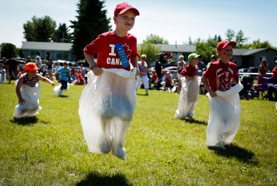 Seven-year-old Scott Sandilands competes in the sack race during Canada Day celebrations in Cremona, Alta., Tuesday, July 1, 2014.(Jeff McIntosh / THE CANADIAN PRESS)