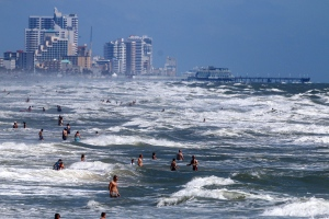 People deal with the high surf and currents off Daytona Beach generated by Tropical Storm Arthur on Tuesday, July 1, 2014. (The Daytona Beach News-Journal / Jim Tiller)