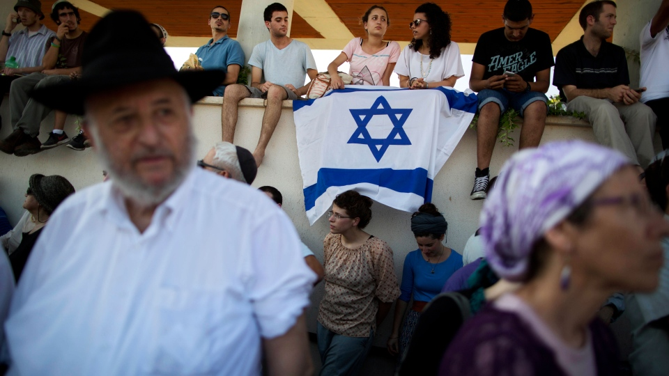 Grief turns to anger as Israel buries 3 teens