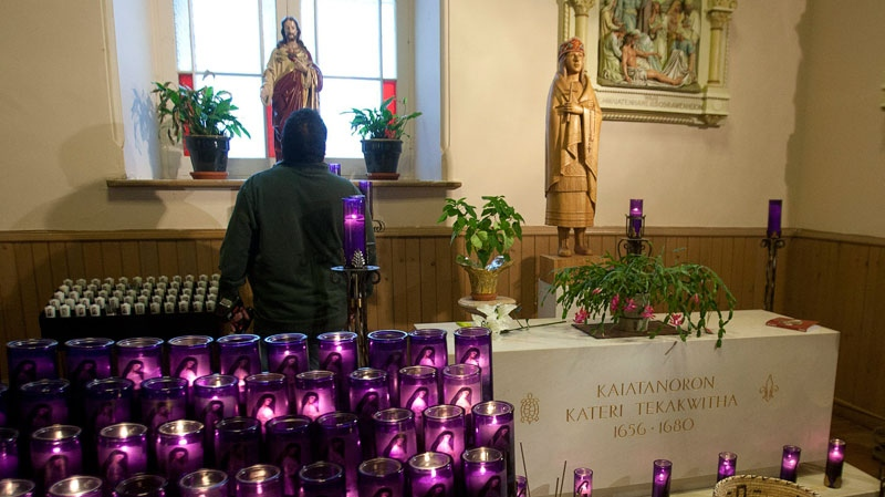 A man looks at the tomb of Kateri Tekakwitha at St. Francis Xavier Church, Monday, December 19, 2011 in Kahnawake, Que, south of Montreal. (Ryan Remiorz / THE CANADIAN PRESS)