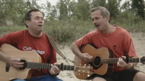 In this screengrab from YouTube, Dave Hadfield (left) and Chris Hadfield (right) appear in their music video 'In Canada.'
