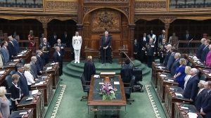 Politicians elected in the June 12 election -- including Premier Kathleen Wynne and her already anointed new cabinet -- are officially made members of provincial parliament at a swearing-in ceremony Wednesday, July 2, 2014.