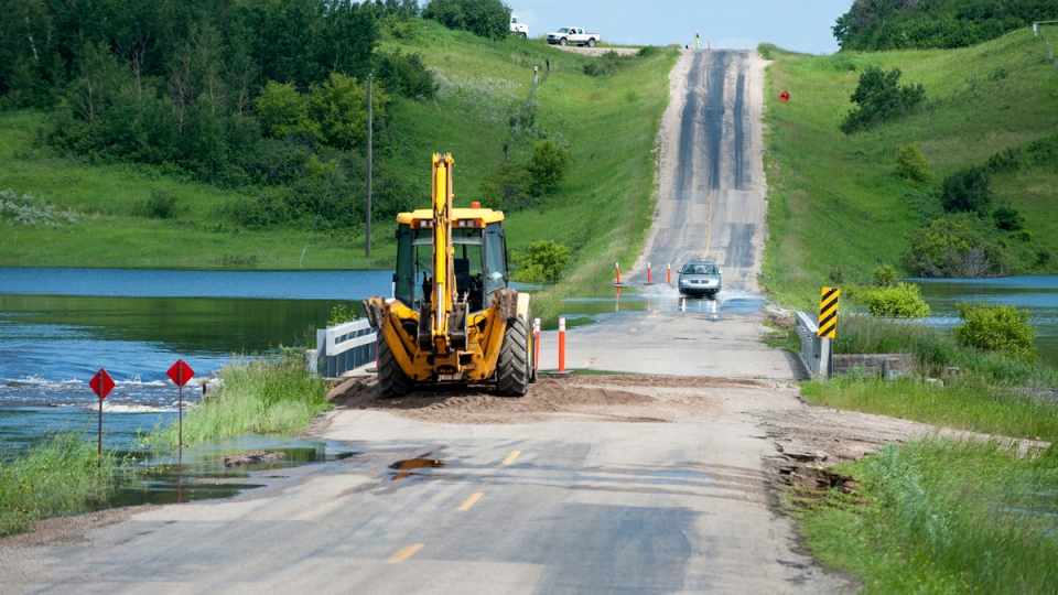 Flooded road in Springside, Sask.