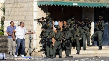 Palestinians argue with Israeli border police