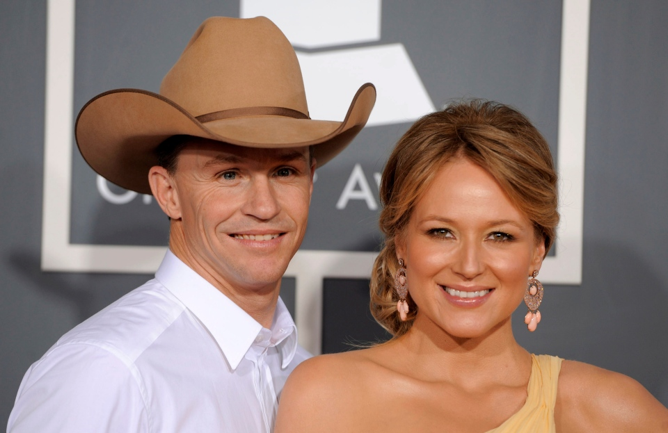 This Feb. 13, 2011 file photo shows Jewel, right, and her husband Ty Murray at the 53rd annual Grammy Awards in Los Angeles. Jewel and her husband are divorcing after a 16-year relationship.  (AP Photo/Chris Pizzello, File)