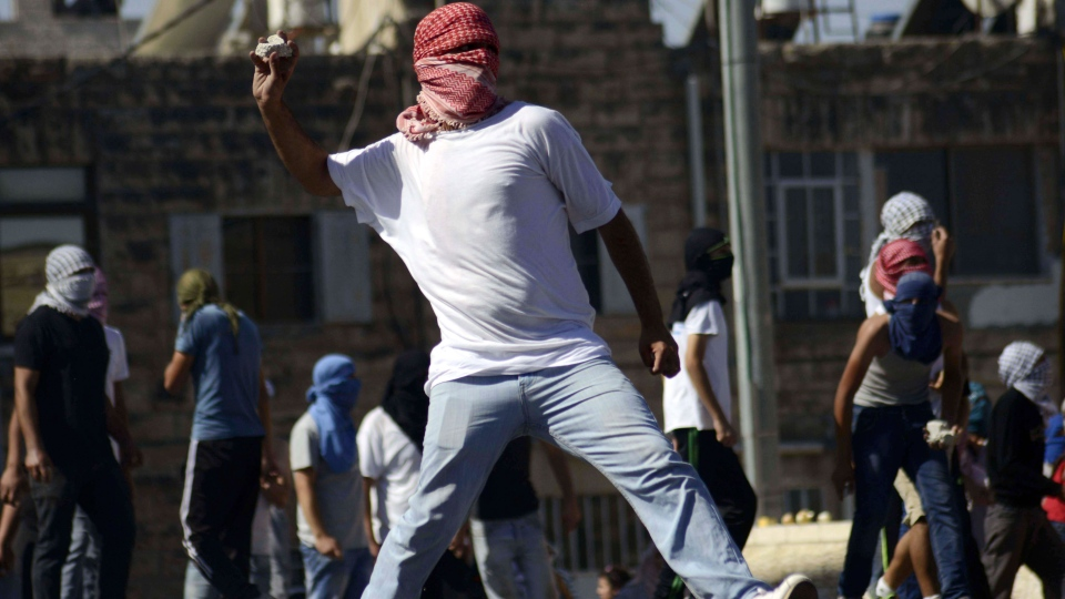 A Palestinian throws a stone during clashes with Israeli border police in Jerusalem on Wednesday, July 2, 2014. (AP / Mahmoud Illean)