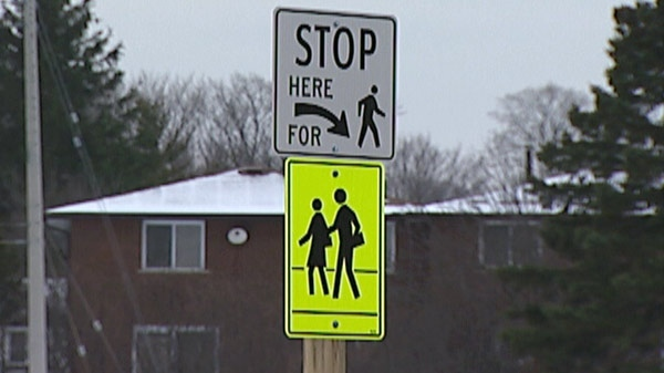 New signs are visible at the Homer Watson Boulevard and Block Line Road roundabout in Kitchener, Ont. on Monday, Dec. 19, 2011.