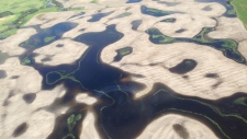An aerial view of the flooding about ten miles north of Alida, in southeast Saskatchewan, is shown on Wednesday, July 2, 2014. (THE CANADIAN PRESS/Don Healy)