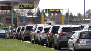Travellers line up at the Canada-U.S. border in this file photo.