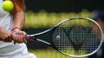 Tennis racquet in play on June 23, 2014. (Pavel Golovkin)