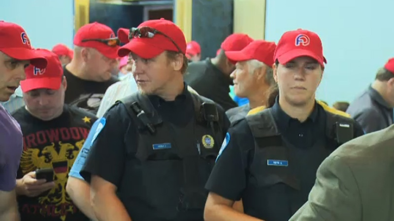 Montreal police will be suited up in red caps and colourful pants as a method to express their objections with changes to their pension plans. (Image: CTV Montreal July 3, 2014)