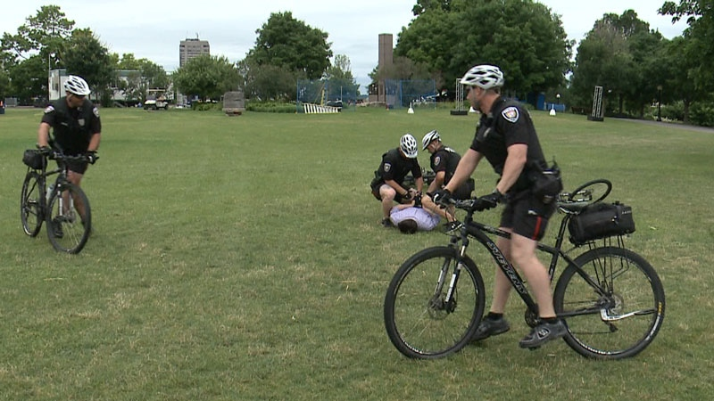 CTV's John Hua gets handcuffed after a strategic takedown demonstration by the Ottawa Police Bicycle Unit. (Photo: Tyler Fleming/CTV Ottawa)