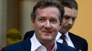 Piers Morgan, host of CNN's 'Piers Morgan Tonight,' leaves the CNN building in Los Angeles, Tuesday, Dec. 20, 2011.