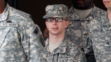 Army Pfc. Bradley Manning, center, is escorted out of a courthouse in Fort Meade, Md., Wednesday, Dec. 21, 2011, after a military hearing that will determine if he should face court-martial for his alleged role in the WikiLeaks classified leaks case went on recess for the day.