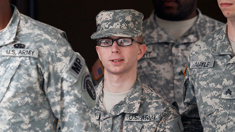 Army Pfc. Bradley Manning, center, is escorted out of a courthouse in Fort Meade, Md., Wednesday, Dec. 21, 2011.(AP / Patrick Semansky)