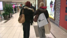 Shoppers pack Toronto and surrounding area malls for last-minute holiday gift spending.