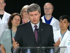 Prime Minister Stephen Harper gestures while making speaking at the Hamilton General Hospital on Tuesday, Aug. 19, 2008.