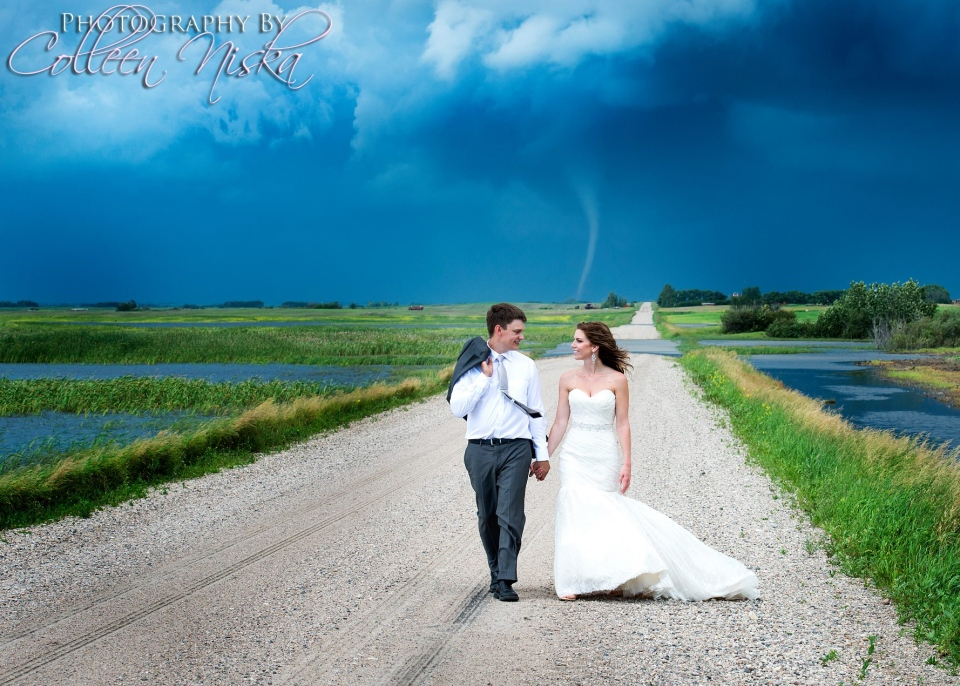 Photographer Colleen Niska captured photos of a bride and groom on a rural road with a twister in the background. (Colleen Niska / Facebook)