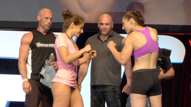 "Canadian bantamweiight Sarah (Cheescake) Moras, left, and unbeaten American Alexis (Sneaky Zebra) Dufresne square off at a weigh-in on Saturday, July 5, 2014, in Las Vegas, in advance of their fight Sunday on ""The Ultimate Fighter"" Season 19 televised card. ( THE CANADIAN PRESS/Neil Davidson)"