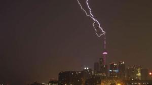 Lightning strikes the CN Tower in Toronto on Monday, July 7, 2014. (George Kourounis / Twitter)