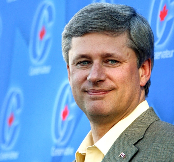 Prime Minister Stephen Harper smiles at the podium where he spoke at a Conservative party BBQ in Kitchener, Ont., on Tuesday, Aug. 19, 2008. (Dave Chidley / THE CANADIAN PRESS)
