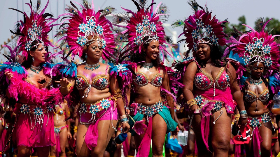 Masqueraders perform as they head down Lakeshore Boulevard during the Grand Parade at the Scotiabank Caribbean Carnival in Toronto on Saturday, August 4, 2012. (Michelle Siu / THE CANADIAN PRESS)