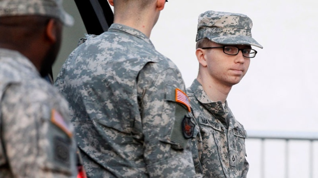 Army Pfc. Bradley Manning, right, is escorted from a security vehicle to a courthouse in Fort Meade, Md., Thursday, Dec. 22, 2011, for what is expected to be the final day of a military hearing that will determine if he should face court-martial for his alleged role in the WikiLeaks classified leaks case. (AP / Patrick Semansky)