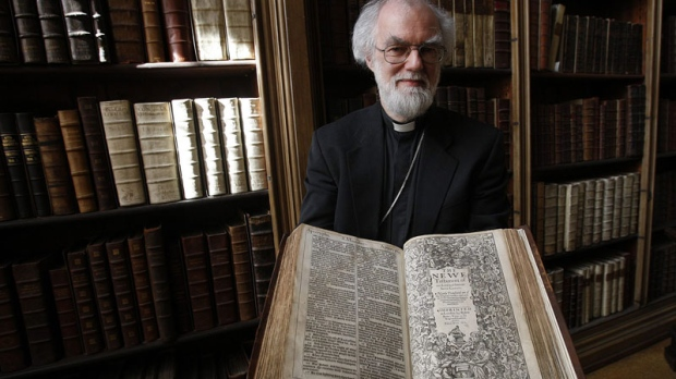 The Archbishop of Canterbury Dr Rowan Williams poses for photographers with the 400 year old King James Bible at Lambeth Palace Library's newest exhibition in London, Wednesday, May 25, 2011. Lambeth Palace Library's new exhibition 'Out of the Original Sacred Tongues', which is open until July 29, 2011, celebrates the 400th anniversary of the King James Version.
