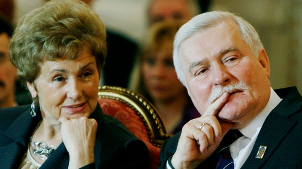 Lech Walesa, right, and wife Danuta Walesa attend a ceremony marking 25 years since Lech Walesa was awarded the Nobel Peace Prizem in Warsaw on Sept. 29, 2008. (AP / Czarek Sokolowski)