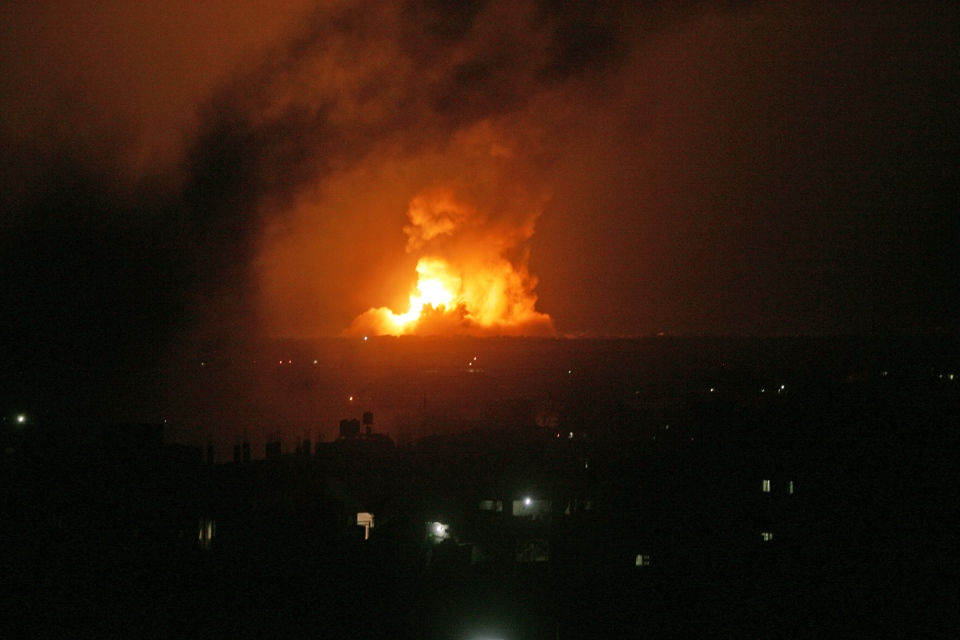 A fireball rises following an Israeli missile strike on the Rafah refugee camp in southern Gaza Strip, early Wednesday, July 9, 2014. (AP Photo)