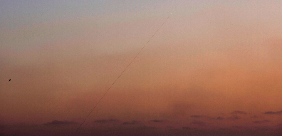 A rocket lunched from inside the Gaza Strip makes its way towards Israel as seen from Israel Gaza Border, late Tuesday, July 8, 2014. (AP / Ariel Schalit)