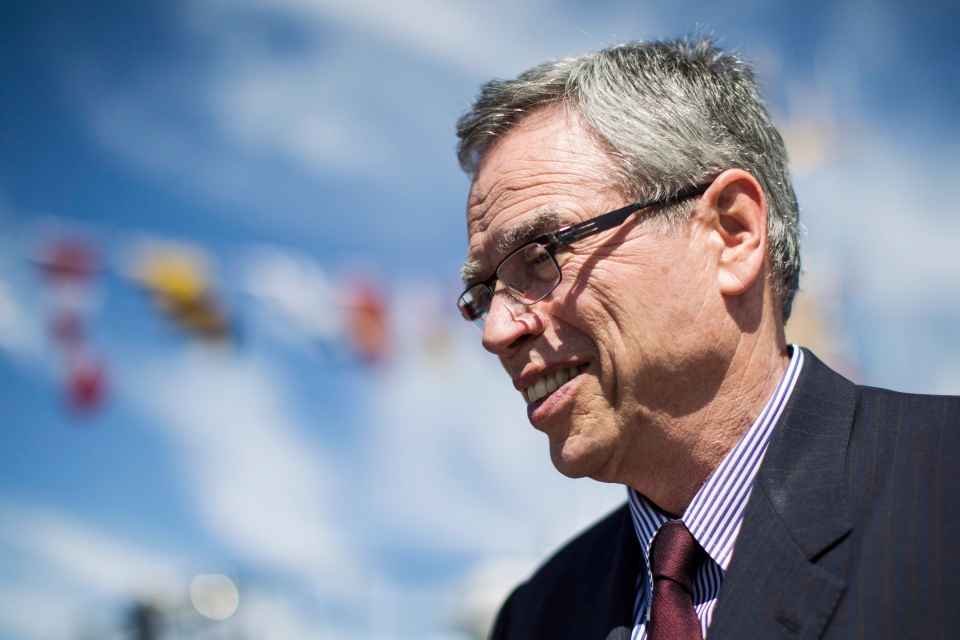 Federal Finance Minister Joe Oliver attends the naming ceremony of CCGS Cpl. Teather C.V., the newest addition to the Canadian Coast Guard Fleet in Toronto on Friday June 20, 2014. (THE CANADIAN PRESS/Chris Young)
