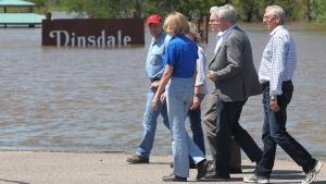 Prime Minister Stephen Harper (grey suit) tours the Assiniboine River flood in Brandon, Man. on Sunday, July 6, 2014. (Tim Smith)
