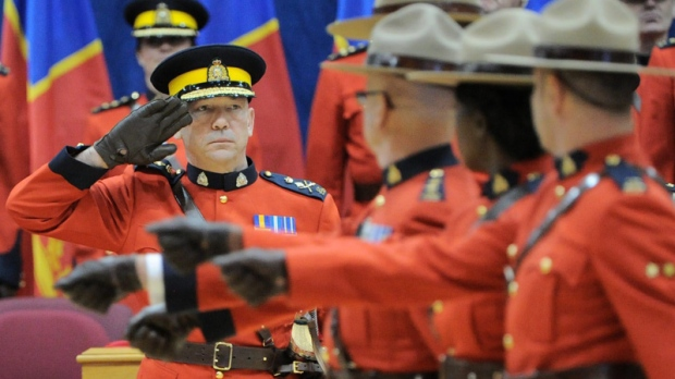RCMP Commissioner Bob Paulson salutes as the parade marches past as he takes part in a change of command ceremony welcoming him as the 23rd commissioner in Ottawa on Thursday December 8, 2011. THE CANADIAN PRESS/Sean Kilpatrick
