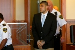 Former New England Patriots football player Aaron Hernandez enters the courtroom for a hearing in Bristol County Superior Court in Fall River, Mass., on Wednesday, July 9, 2014. (AP / Dominick Reuter)