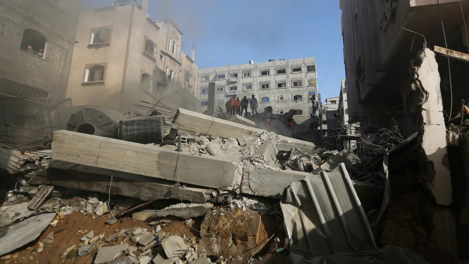 Palestinians inspect the rubble of a house after it was hit by an Israeli missile strike in Gaza City, Thursday, July 10, 2014. (AP / Hatem Moussa)