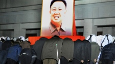 Mourners gather around a portrait of the late leader Kim Jong Il, in Pyongyang, North Korea on Saturday, Dec. 24, 2011.