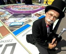 Mr. Monopoly sits by the city of Montreal space on a giant Monopoly board in Montreal, Wednesday, Aug. 20, 2008. (Peter McCabe / THE CANADIAN PRESS)